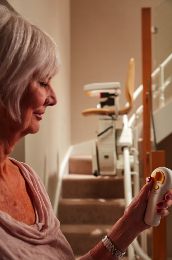 woman using stair lift control
