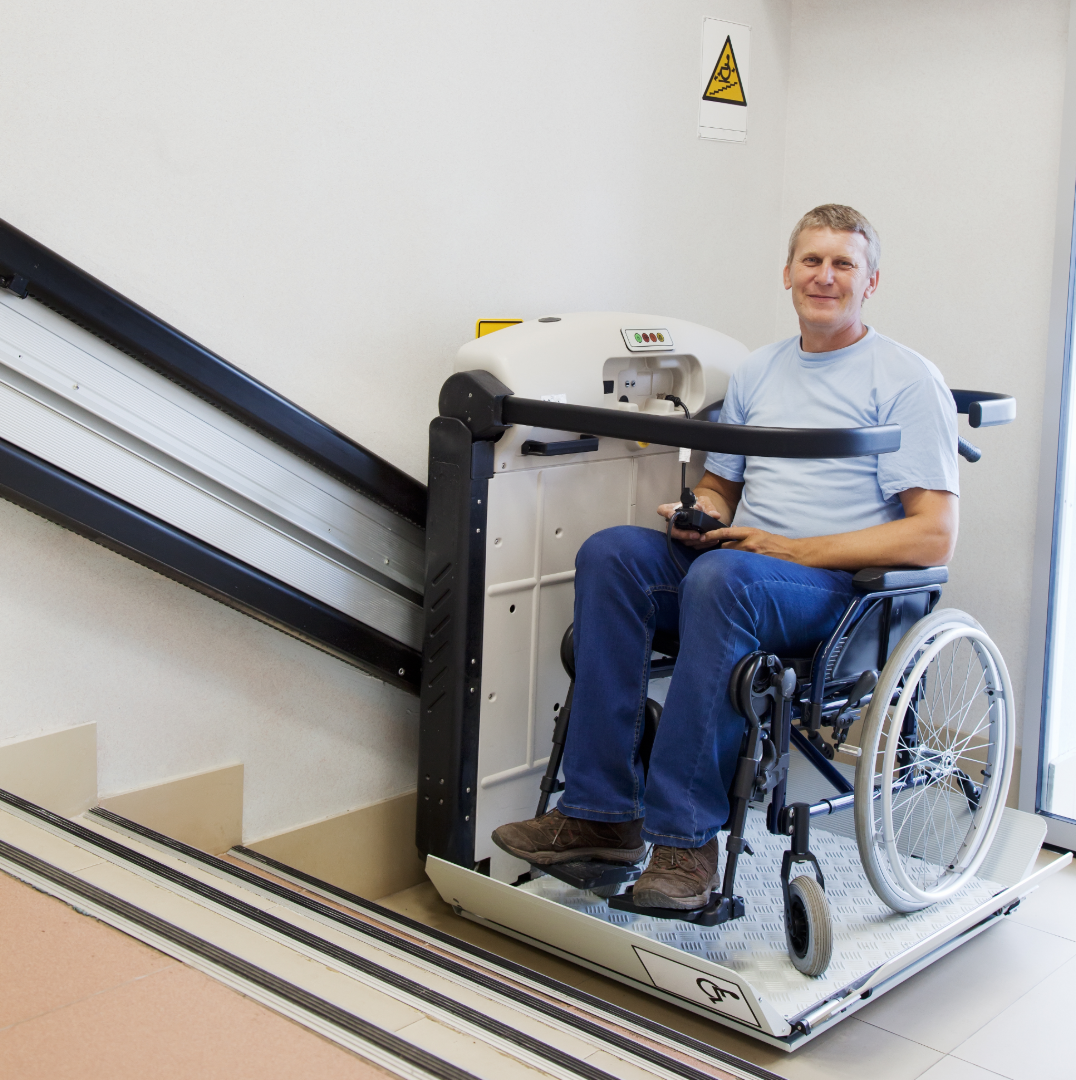 disability access man on stair lift