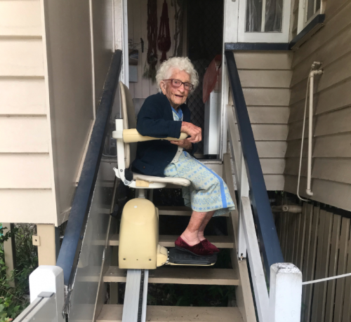 client using stair lift