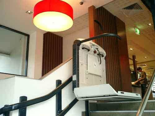 Incline Platform Lift at top of stair inside